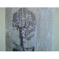 A set of aluminum chain curtain with tree design on it.