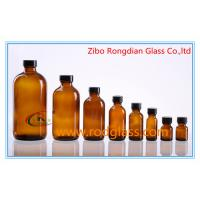 Wholesale Amber glass bottle Boston Round with black phenolic cap from china suppliers