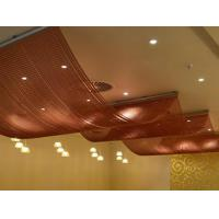 Copper color aluminum chain curtain is installed on the ceiling with a wave structure.