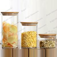 Wholesale High quality round cylinder glass candy jar crystal glass jar with wood lid from china suppliers