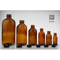 Wholesale Amber glass bottle Boston Round with black phenolic cone lined cap from china suppliers