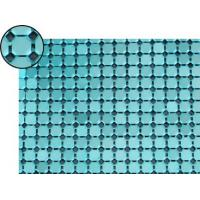 A piece of metallic fabric cloth with blue flat octagon shape.