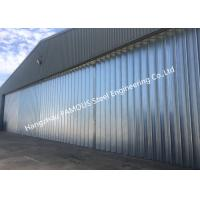 Wholesale Stable Triangular Seal Vertical Hinged Door Sectional Leaves Folding Sliding Hangar Doors from china suppliers