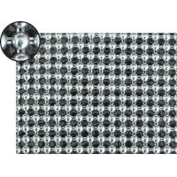 A piece of metallic fabric cloth with round shapes and bright silver color.