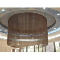Metal coil drapery is installed on the ceilings to form a circle.