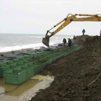 Extra-safe flood barriers are filling with soil using normal fork lift truck