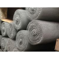 Several metal coil drapery rolls pile up together.