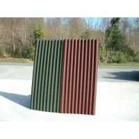 Corrugated cladding, roofing tile, roofing sheet