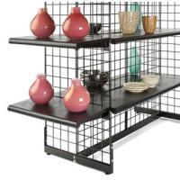 Black gondola grid panels with shelves contain crafts