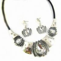 fashionable silver necklace and earrings set with leather