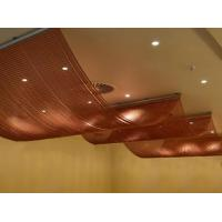 Copper color aluminum chain curtain is installed on the ceilings with a wave design.