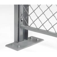 A corner of a wire mesh partition with grey powder coated surface and C-shaped channel protecting the vertical frame