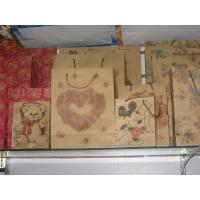 Wholesale Art paper, kraft hand length handle kraft gift paper bags with customized OEM from china suppliers