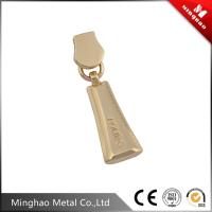 Wholesale Custom engraved letter logo zinc alloy metal zipper puller,light gold zipper slider 14.59*39.87mm from china suppliers