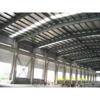 Quality steel structure frame workshop warehouse and sandwich panel wall roof and roller shutter door for sale