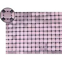 A piece of metallic fabric cloth with lavender color.