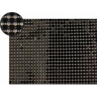 A piece of metallic fabric cloth with black flat octagon shape.