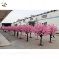 Wholesale UVG Artificial pink flowering cherry tree in wooden trunk for exhibition hall decoration from china suppliers