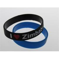 Quality black two colors filled custom silicone wristband debossed and painted bracelet for sale