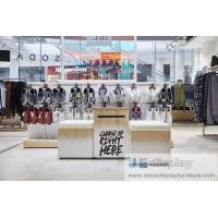 Wholesale Leisure young people Cloth chaine brand store interior by metal display rack and MDF wood veneer panel counters from china suppliers