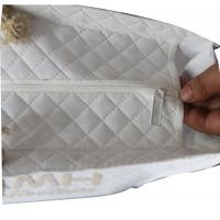Quality Bridal White Quilted NonWoven  Fabric  Small Square Veins Burning Letter Logo Cotton Rope for sale