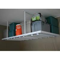 A ceiling-mounted storage rack carry several bulky bags