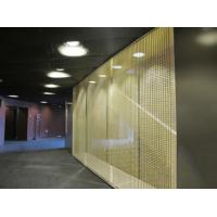 A wall is made of brass cable metal mesh.