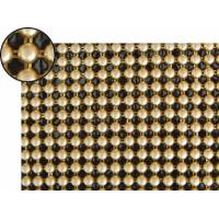 A piece of metallic fabric cloth with round shape and dull polished brass colors.