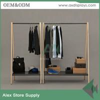 Wholesale High end black clothes shelf display men clothing display rack showcase interior wooden table steel rack from china suppliers
