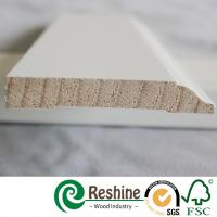 White primer coated pine and fir wood baseboard architrave mouldings