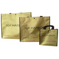 Buy cheap 75g gold shining & black logo and binding , nylon tape handle unwoven fabric carrier bags from wholesalers