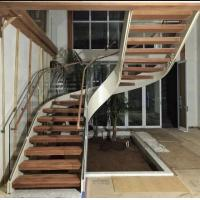 Wholesale Indoor use wood step glass railing steel curved staircase from china suppliers