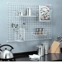 White kitchen grid panels contain kitchen utensils and cookbook