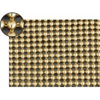 A piece of metallic fabric cloth with round shape and bright brass colors.