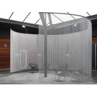 Half circle aluminum chain curtain is installed in the room and many chairs in it.