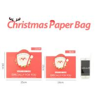 Buy cheap Factory quick ship Xmas Accessories Offset Printed Cartoon Logo Custom Gift Shopping Christmas Paper Bag With Drawstring from wholesalers