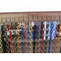 Several different colors of aluminum chain curtains are installed on the flexible track.