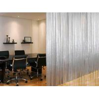A piece of round metallic fabric cloth divides the meeting room.