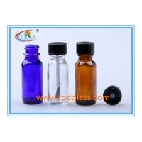 Wholesale Amber glass bottle Boston Round with black phenolic cone lined cap 0.5oz from china suppliers