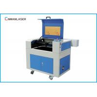 Wholesale Blue Up Down Honeycomb Table CO2 Laser Cutting Machine 6040 For Packing Printing from china suppliers