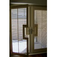 China Basswood Bi-Fold Indoor Window Shutters For French Doors , 64mm on sale