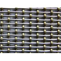 Phosphor bronze pre-crimped wire in the warp and straight ss wire in the weft.