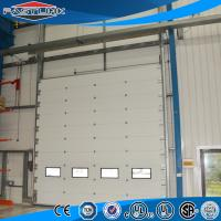 Quality Automatic Lifting  Insulated High Strong Wind Resistant PU Sandwich Panel Sectional Overhead Industrial Door for sale