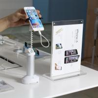 Wholesale COMER alarm anti-theft systems with cable built-in magnetic security counter gripper mobile phone stands from china suppliers