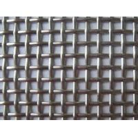 A piece of plain crimped type crimped architectural mesh on the table.