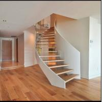 Wholesale Prefabricated steel curved staircase with tempered glass balustrade from china suppliers