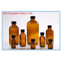 Wholesale Amber glass bottle Boston Round with black phenolic cap,various size from china suppliers
