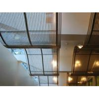 Two pieces of crimped architectural mesh are installed on the ceilings with a wave shape.