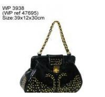 Fashion design handbag with golden studs