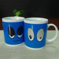 Wholesale Souvenir gift  blue big eyes ceramic mugs stocked white porcelain from china suppliers